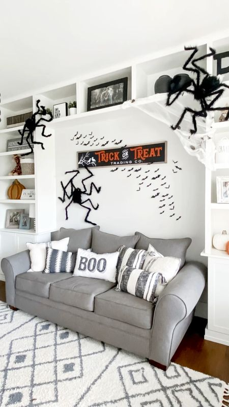 Fall and Halloween decor kids playroom modern farmhouse style gray fabric sofa couch black and white pillows spiders bats trick-or-treat wall sign hand-painted signs seasonal decor  #LTKkids #LTKSeasonal #LTKhome