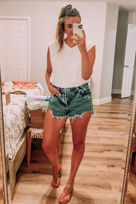 Casual summer outfit. High waisted denim shorts - size up. White cut off muscle tee tank - tts. Tory Burch nude sandals - tts, up if in between.   #LTKstyletip #LTKSeasonal #LTKunder50