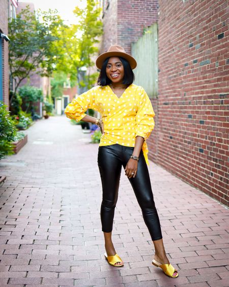 Transitioning summer styles to fall. Polka dot wrap around blouse paired with Spanx, satin slides, and hat. Runs TTS. Use code LOUISA10 to save 10% off your Spanx order.   #LTKunder100 #LTKsalealert #LTKshoecrush