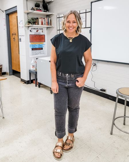 Casual everyday all black teacher mom outfit featuring a black muscle shoulder tee, Levi's black loose straight cropped jeans, a gold chunky toggle coun chain necklace, and copper rose gold Birkenstocks #teacher #mom #fall #allblack #levis #blackjeans #muscletee #shouldertee #chunkychain #petite #midsize #straightjeans #Casual http://liketk.it/3nOhr @liketoknow.it #liketkit