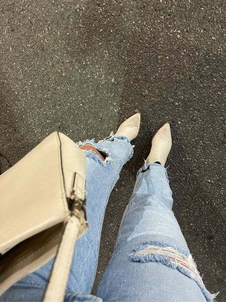 My favorite jeans and boots ever! Unfortunately they don't make these exact jeans anymore but I tagged the same pair without the rips.   #LTKunder50 #LTKunder100 #LTKSeasonal