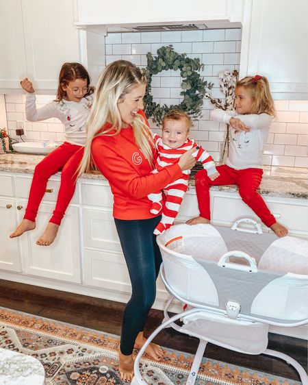 """""""Dance like nobody's watching"""" is a motto we truly live by at the Gilmartin house 💃🏼  If you ever tune into my stories, it's likely you'll catch us dancing in the kitchen in our not so coordinated pajamas on any given morning. These moments are never planned, always fun, and often the highlight of my day.  For the last 5 months, I've always kept a bassinet nearby for a safe place to lay Roe down - one by my bed & another in the kitchen/living room with wheels. (Moms - buy two, thank me later) Sadly, it's time to say goodbye as our tiny dancer is getting extremely active. If you're in the market for one, check out what @deltachildren has to offer like this 2-in-1 Moses basket one.  Who else has frequent family dance parties?  Everything pictures can be found linked in the free @liketoknow.it app! My red sweatshirt is currently on sale and now is the time to buy Christmas pajamas before all the sizes are picked over 🎅🏼 @liketoknow.it.home @liketoknow.it.family #LTKbaby #LTKfamily #LTKkids #liketkit http://liketk.it/30QcU"""