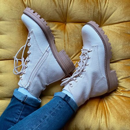 http://liketk.it/3612g Snagged these cute cream canvas lace up boots for a steal. If you like staying on trend but have a tight budget, these are the way to go. They are also super comfy, even after hours of walking in them. They run a tad large, so if you are in between sizes like me (7.5-8), go for the smaller size. #liketkit @liketoknow.it #LTKSeasonal #LTKshoecrush #LTKunder50