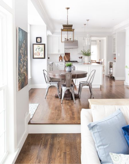 Love all the natural light we get in our White kitchen. Round wooden table, metal chairs, marble countertops #kitchen #kitchentable #potterybarn #target #amazonfinds  #LTKstyletip #StayHomeWithLTK #LTKhome