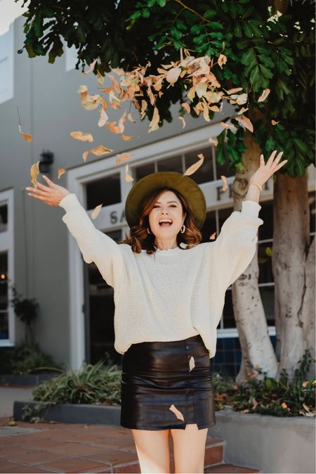 Leather like skirt that has shorts underneath and oversized sweater is the Fall uniform    #LTKstyletip #LTKunder100 #LTKSeasonal