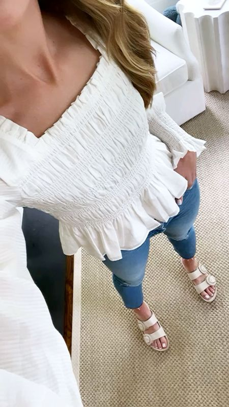 Today's daily look! This top looks rigid but feels SO good...it's a soft cotton. Jeans run true to size and so do my slides! 🤍