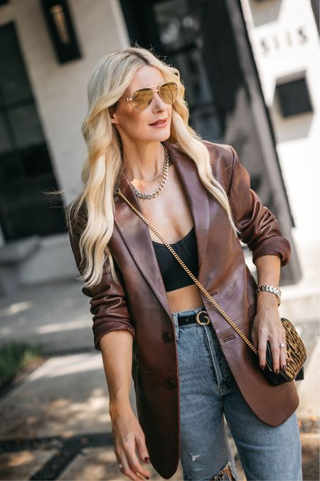 Stepping out of my comfort zone a bit wearing an over-sized blazer and a chic bra top! This amazing leather blazer runs tts, I'm wearing an XS.   #LTKstyletip #LTKunder100 #LTKSeasonal