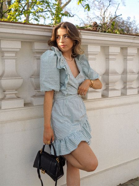 Gingham dresses are perfect for summer and this one is so cute! Wrap style with a puff sleeve, you can't go wrong!     #LTKSeasonal #LTKeurope