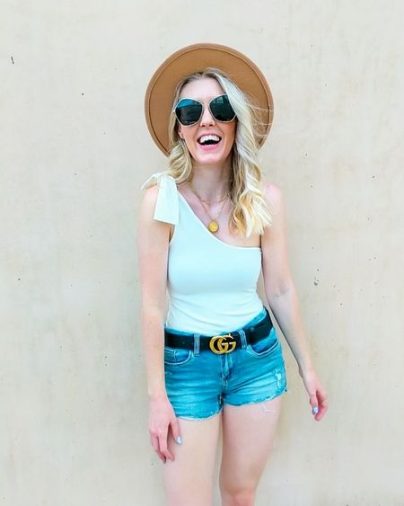 Basics with fun details? Yes please! 🙌 You can't go wrong with good basics and these pieces should definitely be in your closet! Pink Lily one shoulder bodysuit, denim shorts, black double G belt, tan fedora hat, gold paperclip chain necklaces, OPI Ozone You Didn't gel polish. http://liketk.it/3gKFa @liketoknow.it #liketkit #LTKstyletip #LTKunder50 #LTKunder100