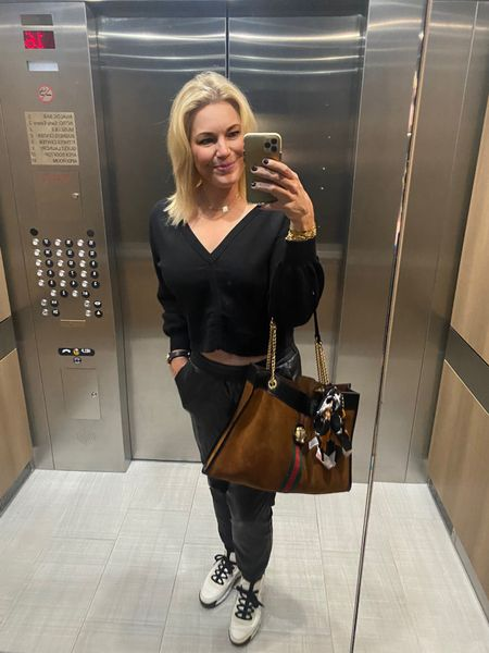 Black on black - especially when it's #fauxleatherjoggers - you will wear these all fall! Plus this sweater is reversible!   #LTKshoecrush #LTKitbag #LTKcurves