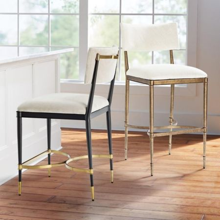 These barstools are so gorgeous! They come in bar height and counter height!  Kitchen Furniture, Dining Furniture, frontgate, Counter Stools, sIlver Tanger, brass hardware, brass kitchen, black kitchen, black furniture, upholstered chairs, fall decor  #LTKhome #LTKstyletip #LTKSeasonal