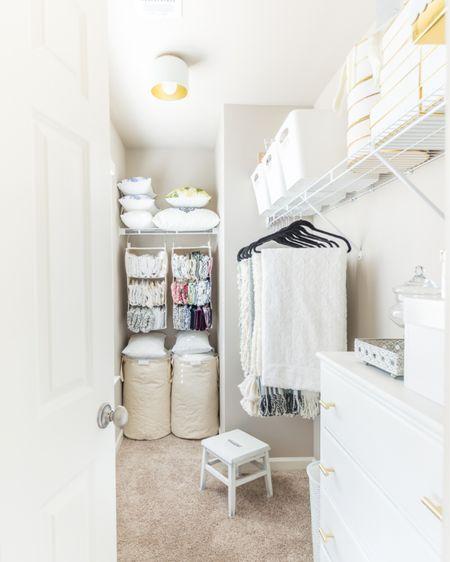 Pillow Storage Solution Throw Storage Solution  http://liketk.it/354Ac #liketkit @liketoknow.it #LTKhome #LTKsalealert #LTKunder50 home decor closet storage pillow organization organization idea storage idea hanging storage