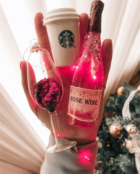 The cutest pink and sparkly Christmas Tree ornaments!  These rosé themed tree ornaments just spoke to me! And of course, can't go wrong with the classic Starbucks coffee cup! I'm excited to add pink to everything this year! http://liketk.it/33hHK #liketkit @liketoknow.it #LTKhome #LTKunder50 #LTKgiftspo #christmastreeinspo #christmasornaments #pinkornaments #winethemedornaments