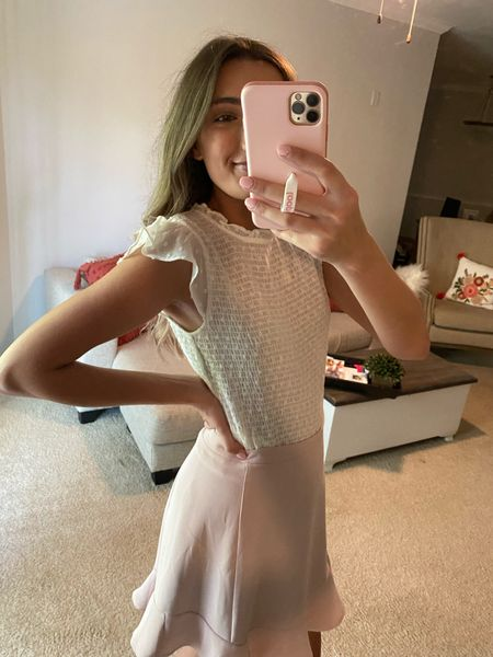 Love this smocked top with ruffles sleeves for work and it's under $30! Comes in pink and black as well.  #LTKunder50 #LTKunder100 #LTKworkwear