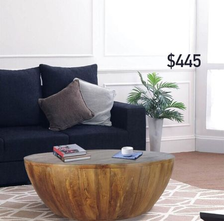 This gorgeous mango wood coffee table in a rounded shape is such a statement piece!   #LTKhome #LTKDay #LTKstyletip