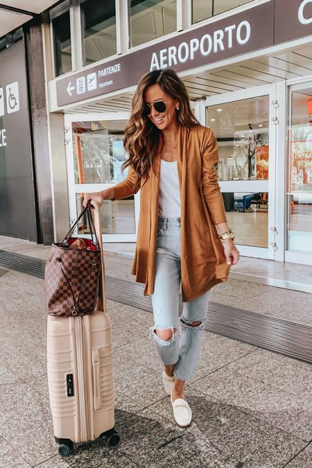 Travel outfit, mom jeans  these jeans are currently part of the Shopbop sale - enjoy up to 25% off with code STYLE   #LTKsalealert #LTKtravel