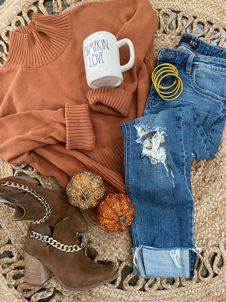 Pumpkin loving🎃🍁🍂  Pumpkin spice outfit for the perfect Fall look🍂🍁 . Wearing this look on repeat! Boyfriend jeans, pumpkin colored sweater, chain booties and Fall mug! 🍁 🍂 #ltkfall #ltkstyle #ltkootd   #LTKSeasonal #LTKunder100 #LTKstyletip