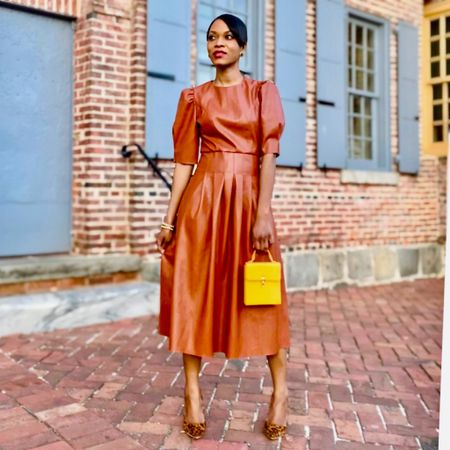 """I'm showcasing my must-have faux leather camel dress.  The puff sleeve and the silhouette of this dress really grabbed👀 my attention and the color is a classic.  This is a perfect go-to piece for days when it's below the 50's, and you're running low on """"cool-weather""""outfit ideas  Leather dresses are office friendly  (Tip: Opt for a mid length style—- A-line, pleated, or pencil hemline is perfect  Pair it with your favorite signature pumps and spruce it up with a top-notch stylish handbag. .For today's look I decided to team up my dress with leopard print pumps, and a vibrant yellow mini bag for a hint of personality. . All handpicked items as seen in the image is featured on my LIKEtoKNOW.it app. So feel free to follow me to get the additional product details. . If you're on the verge to dump the sweats and step out in style once again and would like to work 1 on 1 with me to liven up you current wardrobe get in touch anastaciastyling.com . #anastaciastyling #anastaciastylingtips .  #LTKworkwear #LTKstyletip #liketkit @liketoknow.it http://liketk.it/3cga0"""