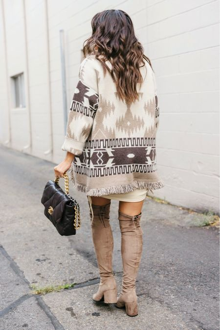 I transitioned a summer dress to fall  but I think I should have taken it straight to winter. I have been freezing all day and there is snow on the mountains!  // Linking all the cute Aztec printed cardigans    #LTKstyletip #LTKSeasonal #LTKitbag