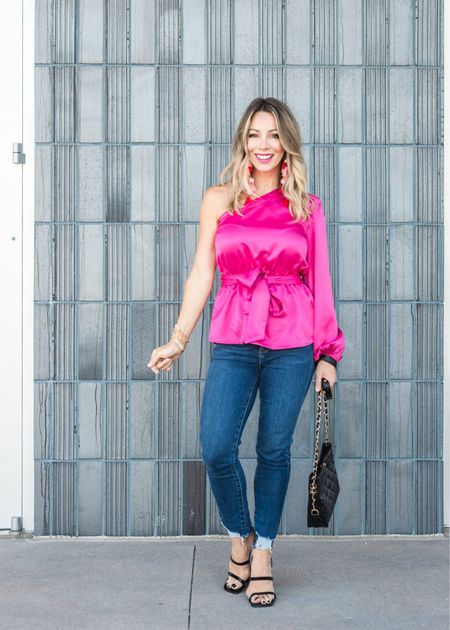 How hot is this pink?! It's definitely a head turner and I paired it with dark denim for a more casual, but still festive look.  Top Fit: I'm wearing an XXS  Jeans Fit: I'm wearing a 25P  #LTKstyletip #LTKSeasonal #LTKHoliday