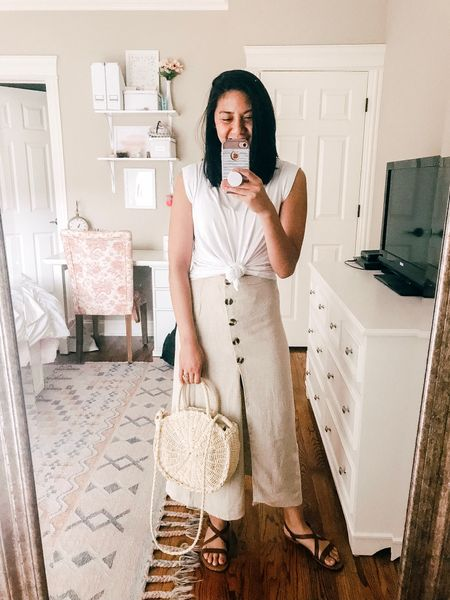 Wearing this high waisted skirt for a summer look by pairing it with a basic white tee (knitted), straw bag, and strappy leather sandals. Skirt fits true to size. // how to style a skirt // summer skirt // how to style neutral // summer outfit ideas. http://liketk.it/2BI3r #liketkit @liketoknow.it #LTKunder50 #LTKstyletip #LTKspring #LTKitbag