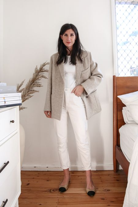 Full neutral toned outfit wearing a beige wool blazer and white mom style jeans with two tone pumps   #LTKSeasonal #LTKaustralia #LTKstyletip