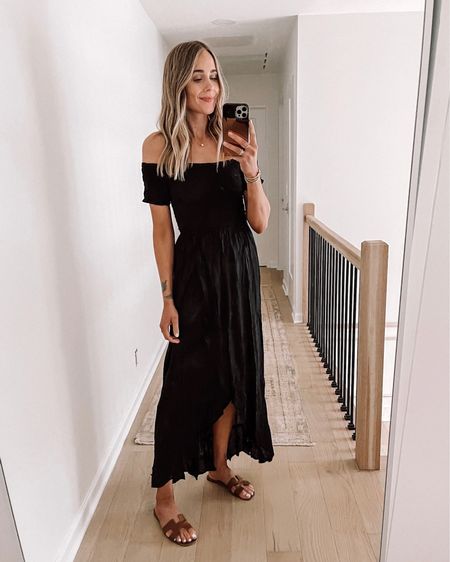 Black swimsuit coverup that can be worn as a regular dress too! Perfect for your next summer vacation. This dress also comes in white! #beachvacation #dresses #coverup #maxidress http://liketk.it/3ijve #liketkit @liketoknow.it #LTKswim #LTKstyletip #LTKunder100