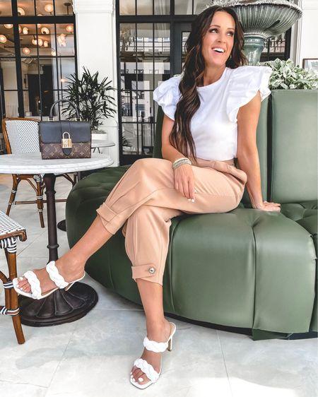 Spring sale at Express!  Sizing info: Top - small Pants - XS (size down) Shoes - TTS  Trousers | brunch outfit | Easter outfit | spring outfit | spring pants | spring trend | braided heels | spring heels | puff sleeves | statement sleeves | trendy shirts | white tee | white heels |    @liketoknow.it #liketkit http://liketk.it/3c6Yh #LTKsalealert #LTKSpringSale #LTKunder50