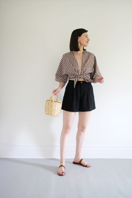 This look is my go-to for when the sassy summer Saturday mood strikes!   Top & shorts old NA NIN (similar linked)  Sandals by Jenni Kayne tts and you can use LEE15 for 15% Off anytime  Birkin Basket Bag is old but I've found identical options on Etsy