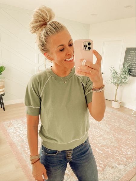 This green raglan sweatshirt is so cute for fall! But I'm probably going to send it back and re-order a larger size. I ordered size small and it's just too small. I would definitely prefer a medium, or even large, in this! But it's only $18 and comes in lots of colors.  #LTKunder50 #LTKSeasonal #LTKstyletip