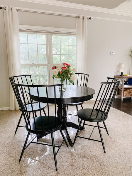 An elegant pedestal table and black dining chairs.  Pedestal table, small seating, spindle chairs, kitchen table and chairs  #LTKhome