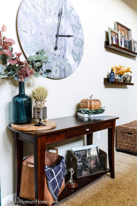 Fall console table for your Fall living room decor.   Tip: When deciding on your Fall decor, start with a color scheme.  This year I went with an autumn inspired theme of yellow, orange, and maroon.   #LTKstyletip #LTKSeasonal #LTKhome
