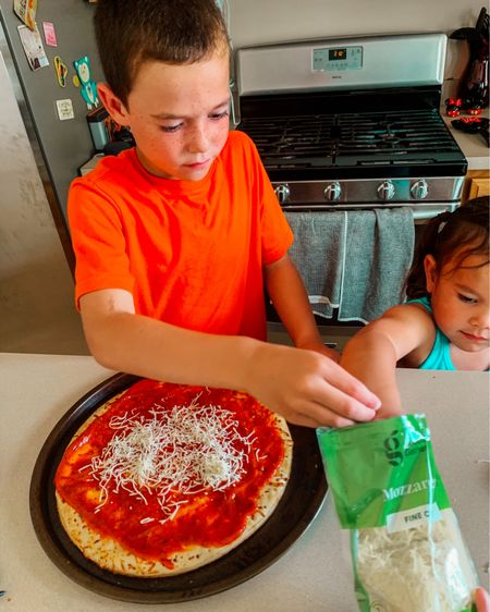 Sometimes we forget that the simple mundane everyday takes we do as moms means anything.  Like meals and cooking.  Not just cooking with our kids.  Just cooking in general.  These are my two littles who love making their own pizzas at home.  But my oldest who is 19 calls me and text me on recipes and how to questions.   She will say things like I miss eating so and so.  Mom how do you make it?    Hearing this put a stop in my step.  You see for her it was home, memories and comfort.  But when we as moms are busy and just trying to survive the long days we just see it as feeding hungry gremlins all day.  But we are creating memories mamas and don't discontinue your love and tireless daily efforts. Kids remember and it will be the simplest of things that bring them home and comfort.    On a side note my family loves the organic brand @goodandgathertarget their pizza crust, cheese and sauces are so yummy.     What is your favorite from @target ?   And I kinda am a sucker for the dollar section...gets me every time.  Lol   Double tab if you can relate 🤣 http://liketk.it/3hwCb #liketkit @liketoknow.it #LTKhome #LTKfamily #LTKfood #LTKkids @liketoknow.it.family Download the LIKEtoKNOW.it shopping app to shop this pic