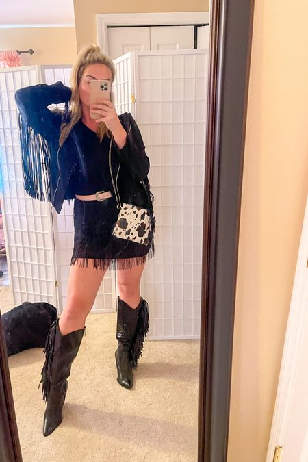 Planning a trip to NASHVILLE so shopping for   Fringe cowgirl boots, fringe belts, fringe  bags, high waisted flare jeans, fringe bodysuits and fringe  jackets!  Basically anything with fringe .  Nashville fashion Outfits for Nashville Outfits for concert Concert outfits   *sizing info: Size down in jacket… I am wearing a medium. Boots run TTS Bodysuit fits so well.. tall girl status approved. I got a large in bodysuit and skirt. If you are under 5 ft 4, you can go with your smaller size if you are in between. I got the large and am happy with the size because I am just under 5 ft 10.  P.S. my dog is not for sale ;)  #LTKstyletip #LTKunder50 #LTKshoecrush