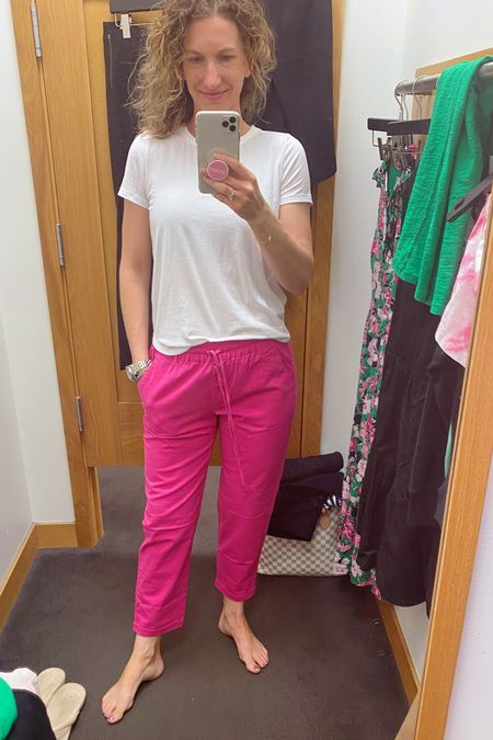 I might have to go back for these linen pants! I am a sucker for linen pants. They are so comfy yet flattering. Who doesn't love a pop of summer color like hot pink!! #linenpants I came in wearing my favorite white tee from kohl's and left with my new favorite Tee called the girlfriend crewneck tee!   #LTKSeasonal
