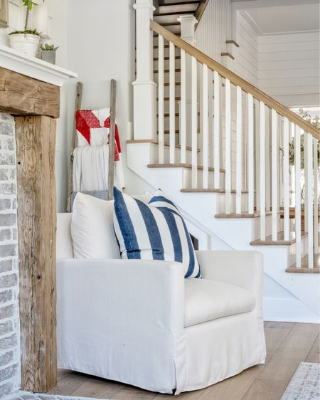Navy and White stripes on an overstuffed pillow and chair invite you to cozy up next to the rustic shiplap fireplace.  http://liketk.it/3iA6p #liketkit @liketoknow.it @liketoknow.it.home   #LTKhome