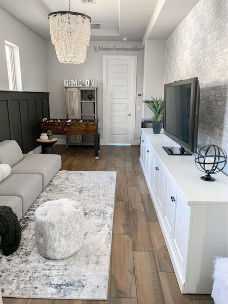 Gameroom at ModernFarmhouseGlam COUPON code MFG60 for 60% off all rugs    Instagram and TikTok @ MODERNFARMHOUSE50   Large white media console table, neutral area rug, black and white distressed rug, beaded Chandelier, Wooden bead lighting, foosball table, black accent table, matte black vase, white vase, peel and stick brick wallpaper, cabinet, storage, accent wall, family room furniture, home decor, living room, teen room  Wayfair, Pottery Barn, Amazon home   #LTKhome #LTKHoliday #LTKSeasonal