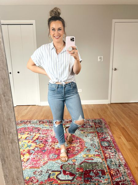 Target Finds: This striped top makes me want to go on vacation! And it's on sale for $15. Paired it with a pair of levis, these cropped straight leg jeans are the perfect jeans for spring, they are an amazon find. and these sandals are a target find and BOGO 50% off right now.   #LTKsalealert #LTKshoecrush #LTKtravel