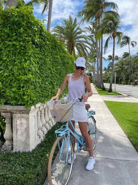 Biking around palm beach! White tennis skirt, tank, white sneakers @liketoknow.it #liketkit http://liketk.it/3fvla #LTKfit #LTKunder100 #LTKunder50