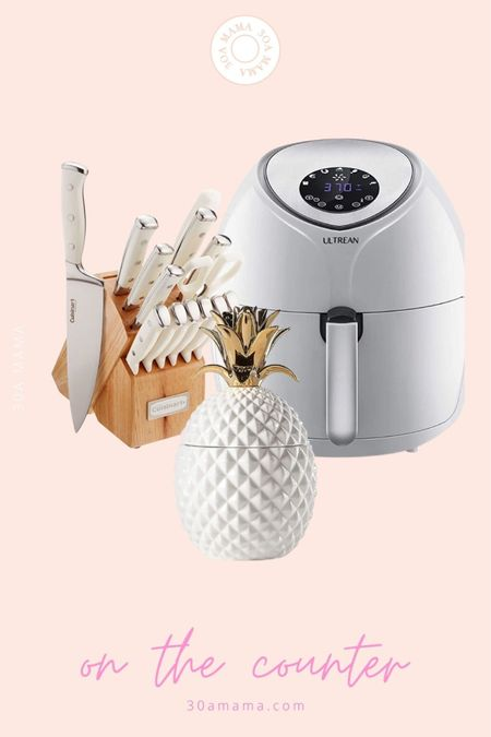 On the counter - large white air fryer, white knife block and a pineapple cookie jar that holds our dishwashing tabs. @liketoknow.it #liketkit #LTKhome #LTKunder100 #LTKunder50 http://liketk.it/3jVLR