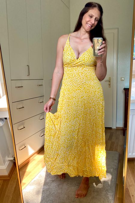 Beautiful, very lightweight and flowy!  Great for a hot day!  The color is so bright and vibrant 💛 I'm a size D cup and that's probably the limit this dress could hold.  Come in LOTS of different colors!!! Wearing a Large I linked 3 other dresses, same style just dots, not flowers      #LTKunder50