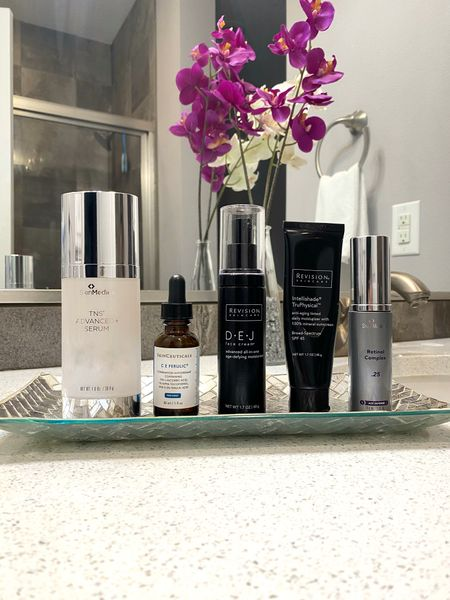 Skincare and anti-aging essentials. I use more than just these products however this is the BASE to great skin in every routine. ➕SkinMedica TNS Advanced+ Serum: Apply morning & evening after cleansing/toning ➕SkinCeuticals C E FERULIC: Hero product of vitamin C serums, potent blend of anti-oxidants, apply AM/PM after TNS serum ➕Revision Skincare DEJ Moisturizer: multitasking moisturizer and anti-aging blend, apply in AM prior to makeup ➕Revision Skincare Intellishade: another great multi-tasker that acts as your sunscreen, tinted moisturizer and also has anti-aging properties in the formula, apply in AM prior to makeup or honestly I use this as my foundation majority of the time and then apply a soft pressed powder, bronzer etc over it ➕SkinMedica Retinol: apply in evening after TNS serum. You NEED to be using a retinol in your routine to encourage cell turnover and more youthful, fresh looking skin.  #selfcare #skincare #skinmedica #skinceuticals #antiaging #dermstore #revisionskincare #thebookofcaleb #midwestblogger #desmoines #iowa   #LTKbeauty