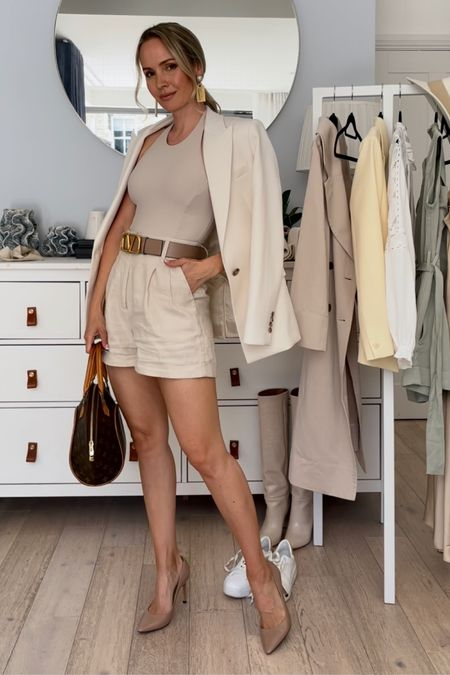 I'm 5'5 abs I'm wearing size UK 6 I'm my beige linen shorts and the white blazer  My nude pumps are true to size.   My beige reversible Valentino garb ani belt is size 75 cm and fits perfectly on the hip, but I had to make a smaller hole in the waist.  The body is unfortunately old, but I have linked some similar ones   #LTKstyletip #LTKDay #LTKSeasonal