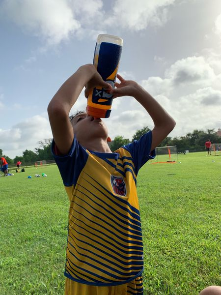 It's HOT 🥵 outside. But Soccer ⚽️ doesn't stop! My boy is hydrating with his Gatorade Squeeze Bottle. #Soccer #Kiddos #Hydration #Sports    #LTKkids #LTKfamily