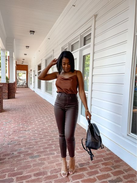 I asked you guys in my stories if you felt like this week was flying by or dragging on and a lot of you feel like me; this week is DRAGGING! Lol // I've been loving these leather type pants for Fall and I snagged these from @express during their sale. Wearing my true size. Linking this entire outfit over in the @shop.ltk app! >> • • • #ltkseasonal #ltksalealert #expresspartner #expressyou #blackfashionbloggers #falloutfitideas