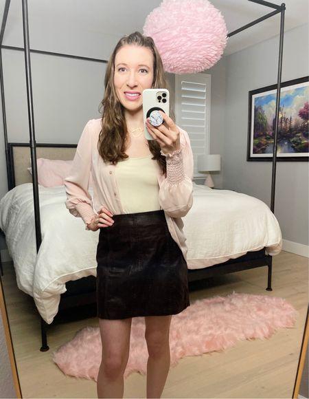 Anthropologie monogram necklace D Express smocked cuff portofino shirt Free People modern femme mini skirt  Perfect spring transitional outfit     #LTKVDay #LTKSeasonal #LTKsalealert