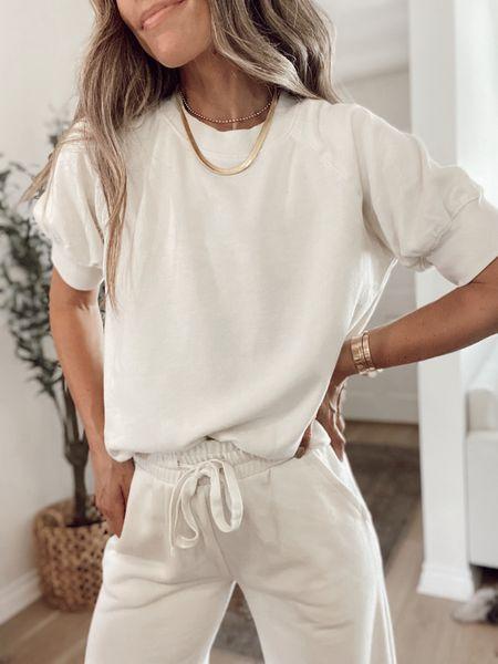 Super soft vintage short sleeve sweatshirt + matching wide legged cropped lounge pants. Sustainably made, under $40 for both. Run true to size   #LTKunder50 #LTKstyletip