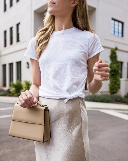 Okay, hear me out on this tee. I know that $125 is a splurge, but this is THE only white tee you need in your closet. It doesn't shrink, it's soft but not clingy, and it tucks easily into jeans/shorts because it's the right length. More options linked as well from some of my favorite t-shirt brands if you're not ready to take the plunge!   #LTKSeasonal #LTKstyletip