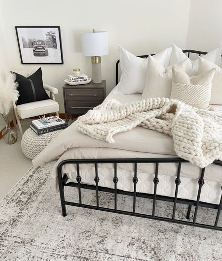 """H O M E \ Guest bedroom refresh👌🏻 Neutral bedding paired with a cozy corner😍😍 West & Ford """"helped"""" me style/make the bed today… it took about an hour🤣 Showing a closer look on stories!  Sharing a before & after of this space on the blog later this month… it 'twas rough😵 Shop this room now over on the LTK app! Click the link in my bio🙋🏻♀️ Nighty, night boo😴  #bedroom #bedding #homedecor #bedroomdecor #cozyhome  #LTKhome #LTKSeasonal"""