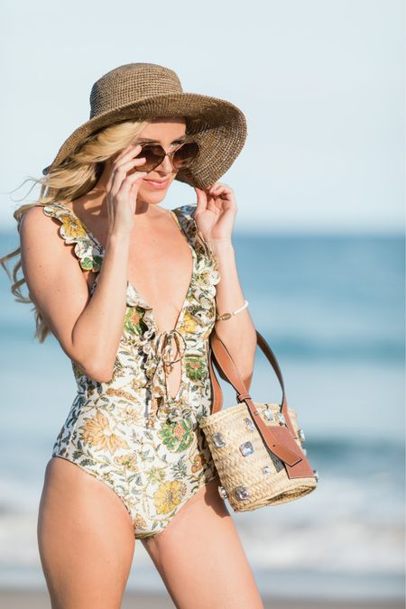 """Going Boho at the beach!? Bravo!  I love trying to make a beachy bohemian look breath a touch of """"glam."""" It's a great balance for a beautiful beach day. This swimsuit by  is the perfect mix of feminine and flirty.  Add some sharp shades and a killer bag and you'll be the babe of the beach 🖤 Shop my look here:  http://liketk.it/2LsWN #liketkit @liketoknow.it   Photo Cred:"""
